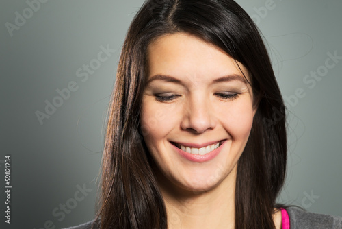 canvas print picture Glückliche Frau mit einem strahlenden Lachen