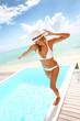 Beautiful woman in bikini enjoying pool time