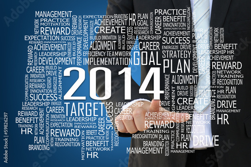 Businessman pointing 2014 business concept