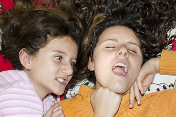 little sister girls fighting angry in bed