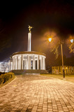 Night shoot, paved walk to monument of heroes Skopje Macedonia poster