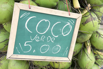 Green Drinking Coconuts for Sale Sign in Brazil