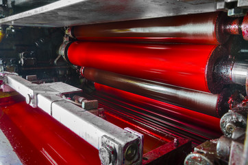 print machine, red color drum, dramatic light
