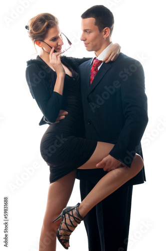 Beautiful sexy lady seducing young businessman