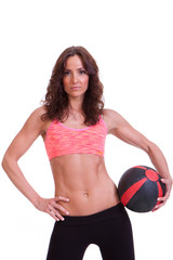 A beautiful young woman ready for medicine ball exercise