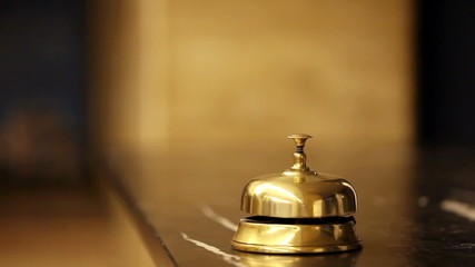 call at old hotel bell on a marble stand