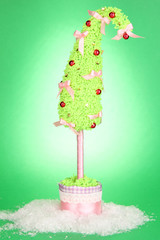 Christmas tree with curved tip on green background