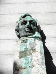 Face Statue of President Abe Lincoln sitting on a pedestal