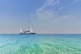 Seascape with sailboat at sea horizon