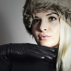 Girl in Fur Hat. Beautiful Blond Woman in Black Leather Gloves