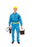 Worker with helmet holding a drill and a tool box