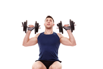 Young man working with dumbbells