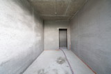Empty room with rough finish in construction building