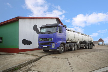 Truck for production of milk loading stand near barn