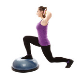Athletic woman working her legs on a bosu ball