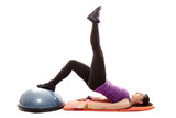 Athletic woman working her legs and bottom on a bosu ball