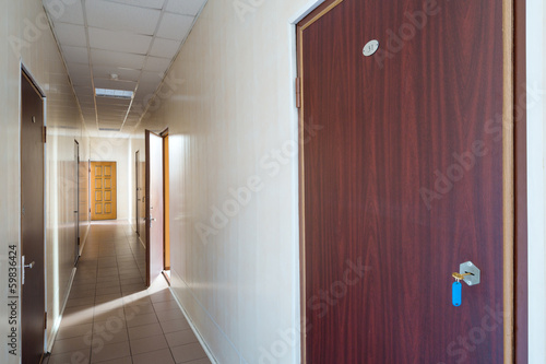 Corridor with an open door in office building