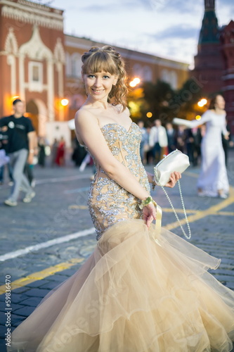girl in elegant dress on the Red Square in Moscow