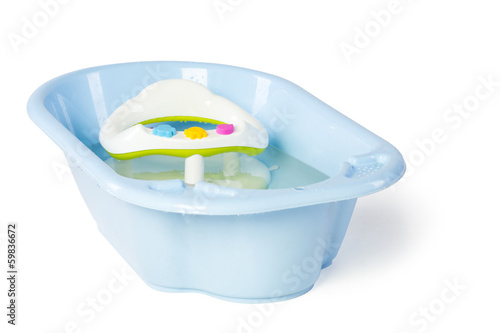 Empty baby bath with water in studio