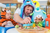 Father with daughter and baby boy celebrate birthday