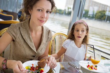 Mother and daughter eating at the floating  restaurant