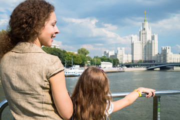 Mother and daughter traveling by ship on river