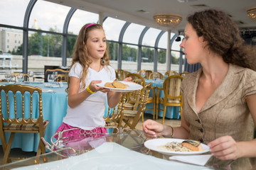 Daughter mother sends food in a floating restaurant
