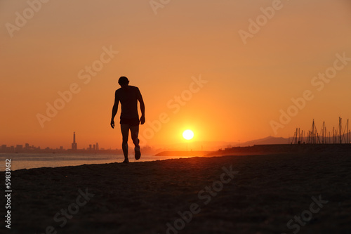 Jogger silhouette walking exhausted after a hard training