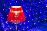 modern vibrant red table lamp and contrast blue sofa