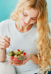 Female model eating green salad