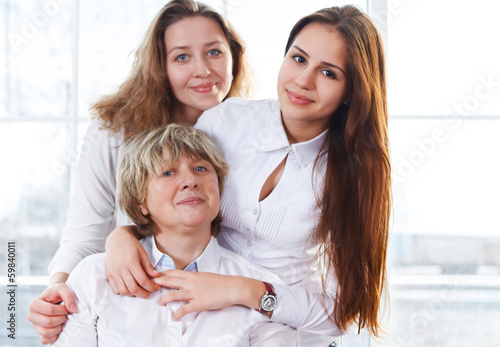 Portrait of a mature mother and adult daughter and teen granddau
