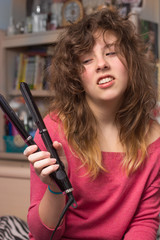 Girl with fizzy hair and flat iron