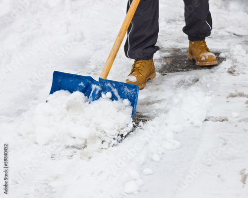 Clearing snow with shovel after storm - 59840452