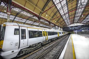 Modern Commuter Train inside Victoria Railway Station in London