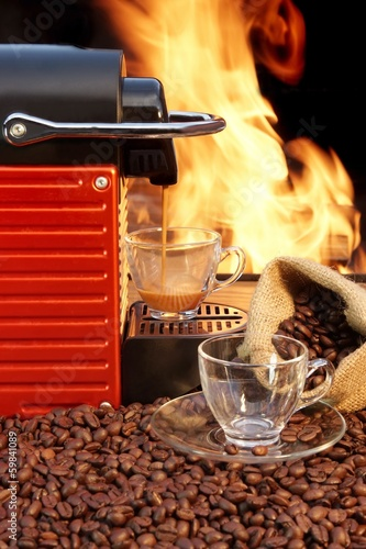 Coffee machine with two cups  of espresso and fire background