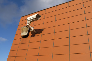 Surveillance camera on a wall.