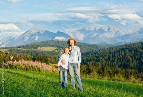 Family on summer mountain hill (Poland)
