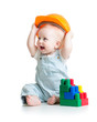 kid playing with building blocks toy