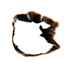 burned hole on a white paper background