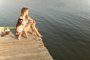 Mother and daughter on the pier