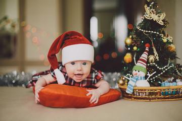 Baby in a cap of Santa Claus