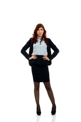 Confident business woman wih hands on waist