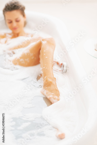 Closeup on young woman relaxing in bathtub