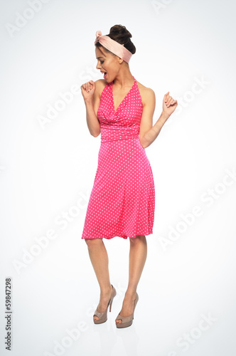 Old-fashioned young woman dancing
