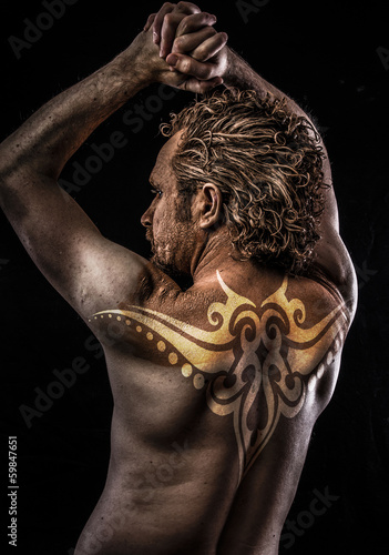 Male model with tribal tattoo, evil, blind, fallen angel of deat