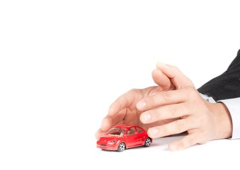 businessman protect with hands a car, insurance concept