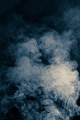 abstract background of blue smoke on a black background