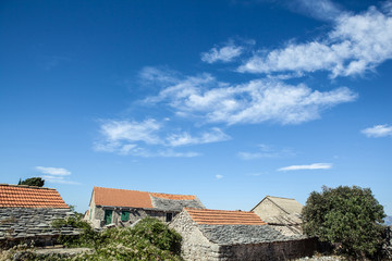 old stone rustic house and blue sky