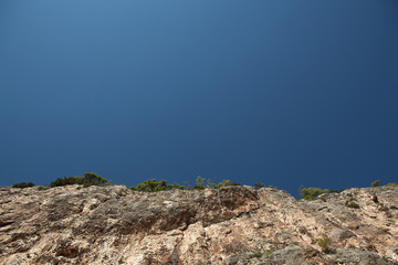 umber mountains and blue sky