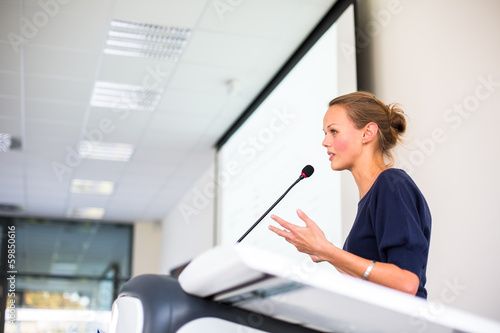 Pretty young business woman giving a presentation